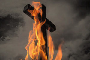 Cheap grace represented like a cross engulfed in flames